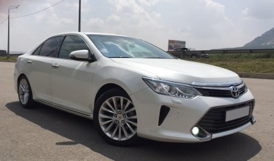 Hire Toyota Camry 55 with driver in Kharkiv